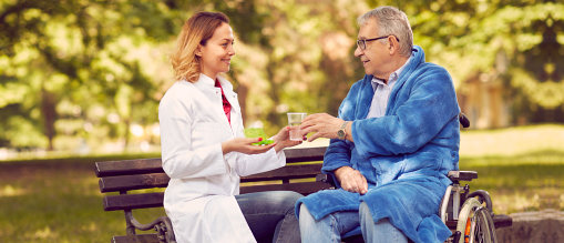 Nurse giving therapy medicine to senior man